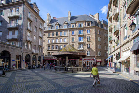 english famous: SAINT-MALO, FRANCE - CIRCA JUNE 2014: In the streets of Saint-Malo. Saint Malo is famous walled port city in Brittany in northwestern France on the English Channel.