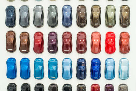 paint samples: Car metallic paint samples, stand with examples of glowing colors coating for different vehicles, bronze, brown, orange, purple, green, blue, azure, red variations of transport bodywork surface