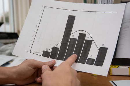 analyst: Business analyst examining diagram Stock Photo