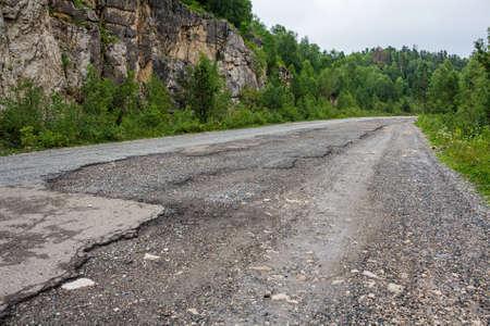 damaged: Damaged asphalt road Stock Photo