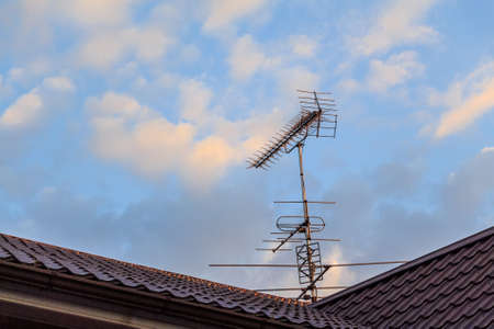 Rooftop television Yagi-Uda antennas on sky background