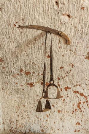 stirrup: Old stirrup on wall Stock Photo