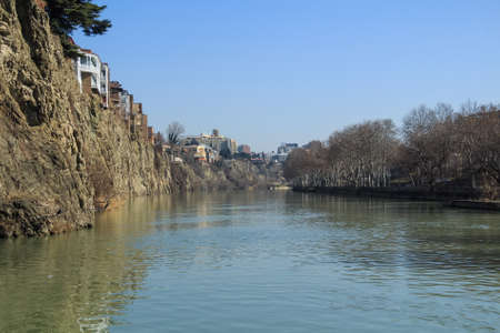 Houses on edge of cliff above river Kura, Tbilisi