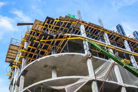 plastered wall: Construction site of building with crane Stock Photo