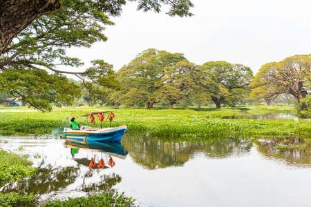backwater: Beautiful traditional asian boat on lake Stock Photo