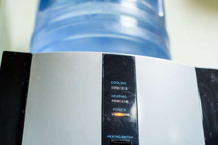 black appliances: Close up fragment of modern water cooler
