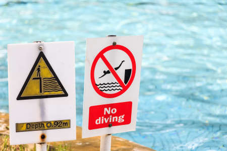 Close up of signs in swimmimg pool