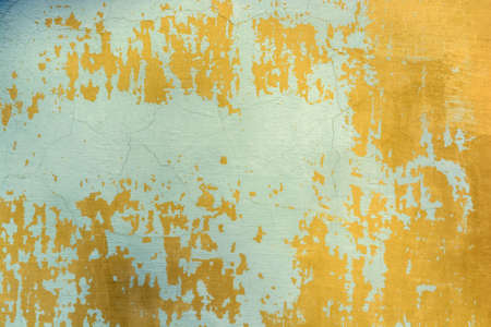 Blue cracked painting on old plaster wall surface