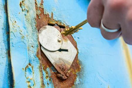 Close-up of opening old rusty metal door