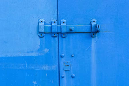 rusty nail: Old blue door hinge