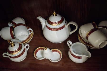 teaset: Close up of white decorated china teaset
