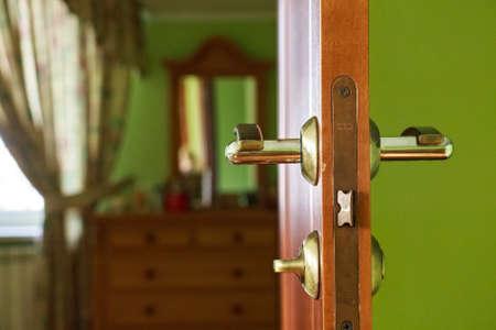 Modern opened brown wooden door indoors Stock Photo