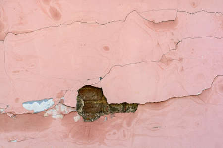grey pattern: Cracked pink cement plaster texture