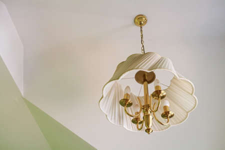 chandelier: Modern white plastic chandelier hangs from ceiling