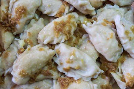 stuffing: Close up vareniki or Russian dumplings with onion