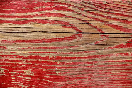 corroded: Red cracked painting on wooden surface