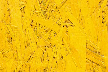 Close up bright yellow particle board surface