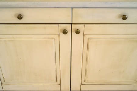 closet: Close-up white cupboard wooden doors