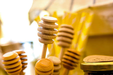 drizzler: Several wooden honey sticks Stock Photo