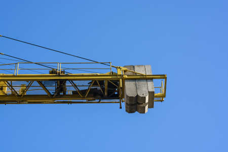 Close up construction crane builds new building Stock Photo