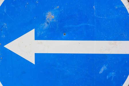 one lane sign: Blue arrow traffic sign turn left