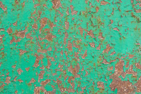 Green cracked painting on metal surface Stock Photo
