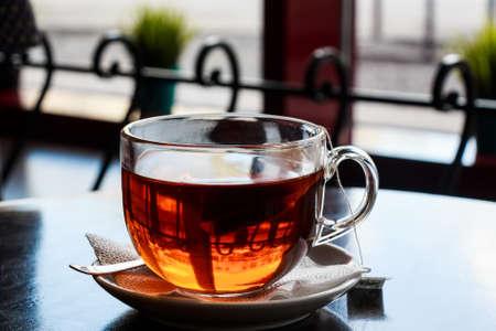 Tea bag put in transparent glass teacup Stock Photo