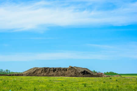 Pile of soil on sunny day Stock Photo