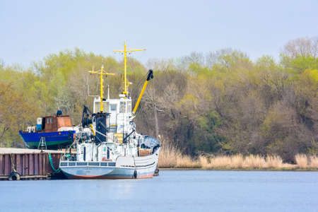 stay at the course: Small tow boat floating on the river Stock Photo