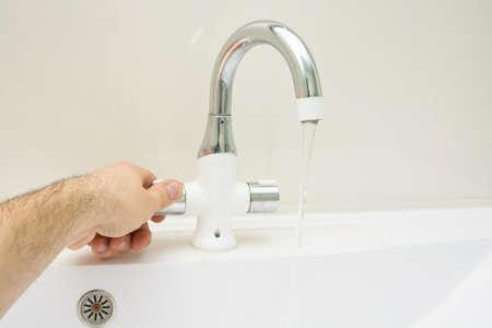 sink drain: Modern bathroom with chrome tap