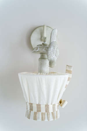 Close up white vintage wall lamp