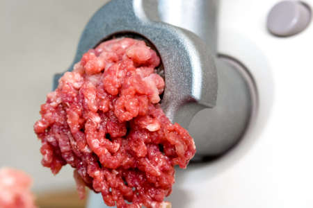 Closeup of front part of meat grinde