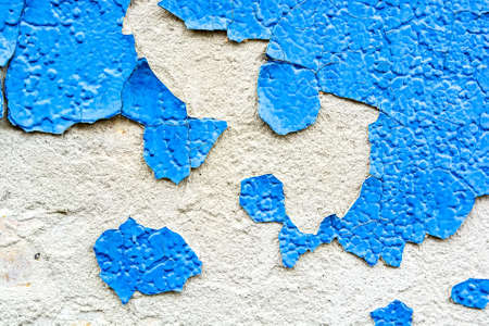Blue cracked painting on plaster surface