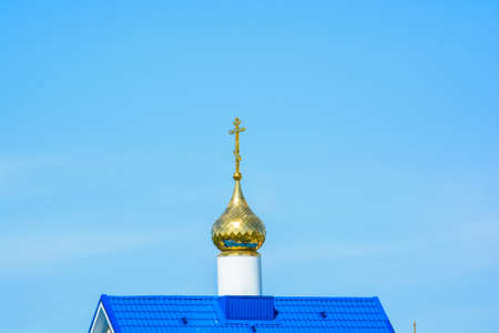 Detail of small Orthodox church with golden cross