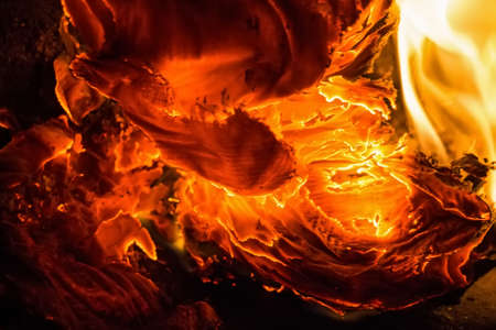 Close up paper burning in flame Stock Photo