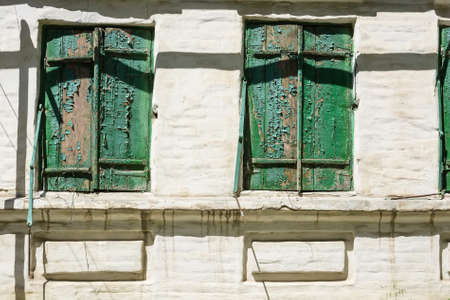 shutter: Old green wooden window shutters of rustic house Stock Photo