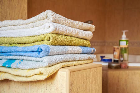 Colorful towels lie in the bathroom Stock Photo