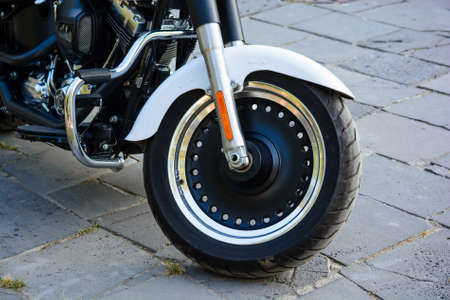 Closeup image of tire of modern motorcycle parkes in street 写真素材