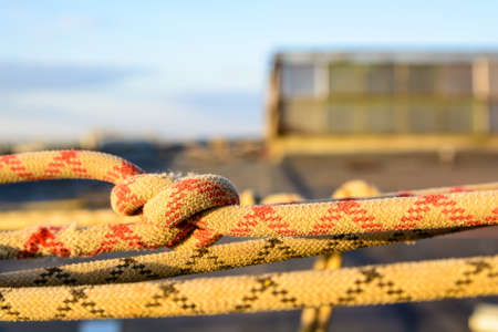 Closeup stretched and tied industrial braided rope Stock Photo