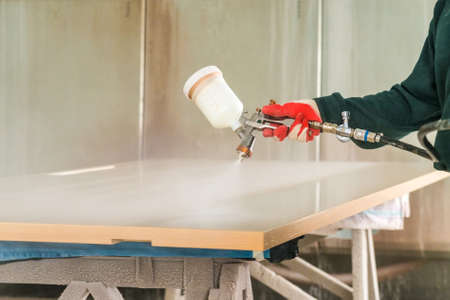 Staining wood with spray gun Stok Fotoğraf