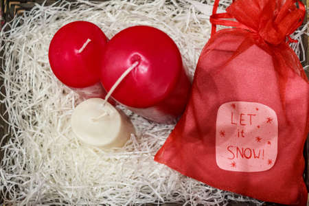 Christmas decoratios colorful candles and red bag Stock Photo