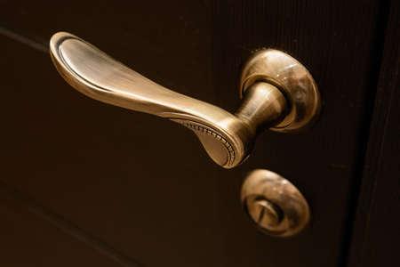 Closeup of metal bronze doorhandle