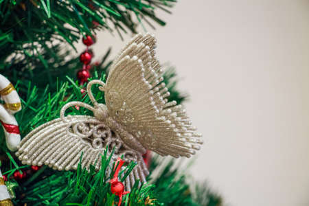 Close up Christmas toy of butterfly on tree