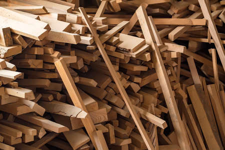 A bunch of wooden beams stored at a carpentry