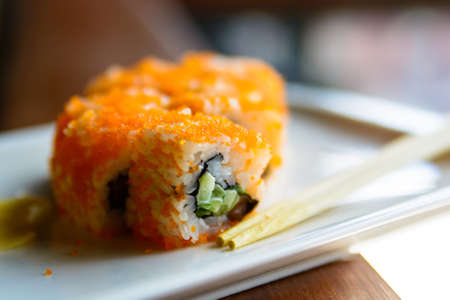 Close up tasty Japanese rolls on plate Stock Photo