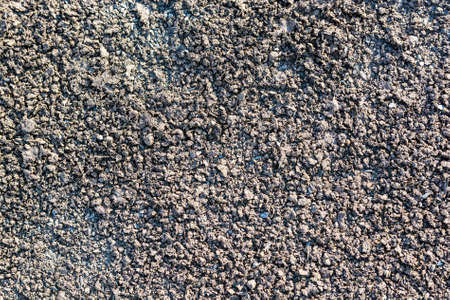 Abstract background of closeup dark old asphalt