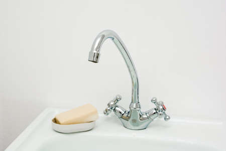Modern bathroom washbasin with chrome water tap and soap Stock Photo