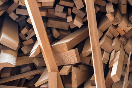 Close up pile of newly made wooden beams at a workshop