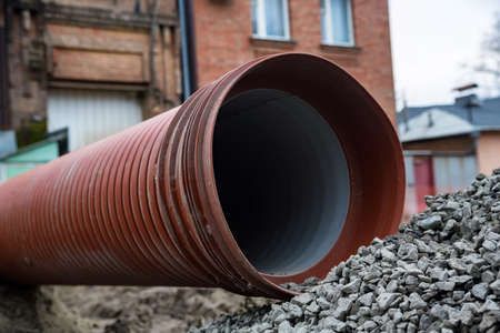 Industrial corrugated pipe at roadworks site