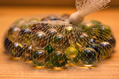 Colorful glass marbles in net Stock Photo